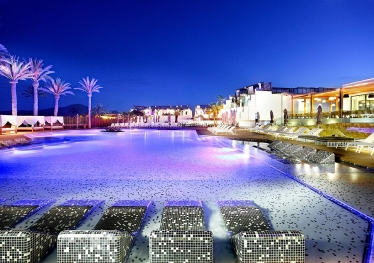 Goregous-Eden-pool-area-illuminated-at-night-Hard-Rock-Hotel-Ibiza